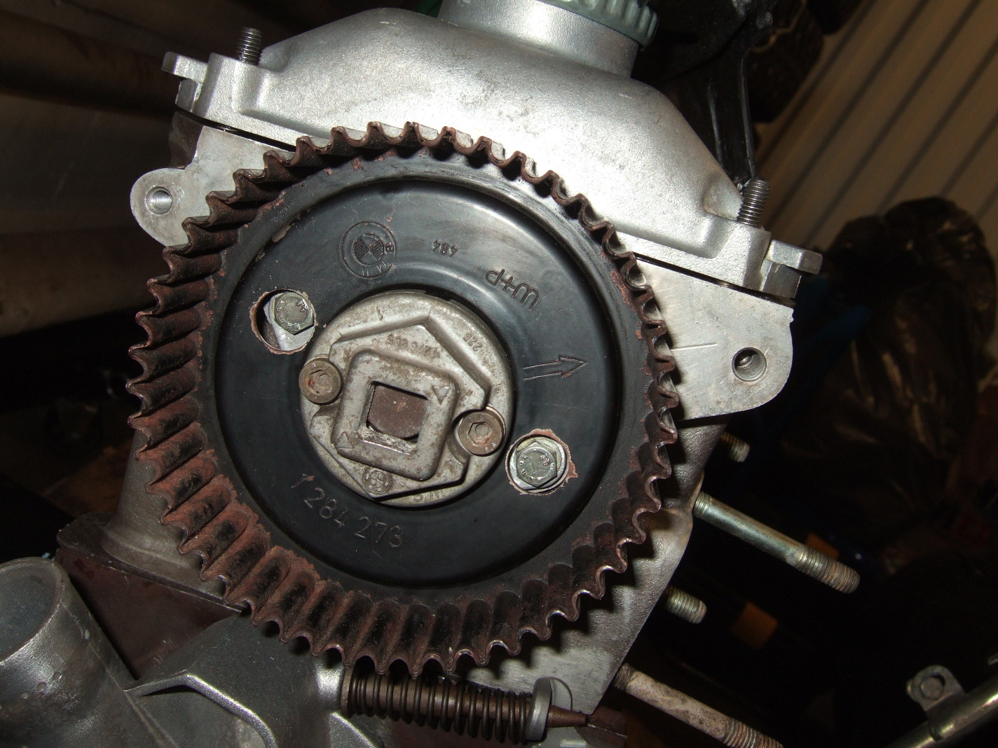 Make sure the arrow in the camshaft belt sprocket lines up with the line in  the cylinder head.